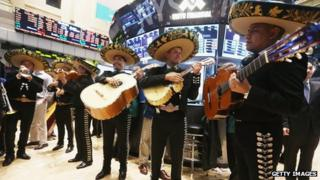 The band Mariachi Real de Mexico waits to perform on the floor of the New York Stock Exchange ahead of the Cinco de Mayo holiday