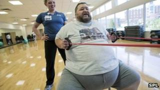 Obese man exercising