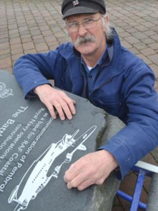 Malcolm Gray with the memorial stone