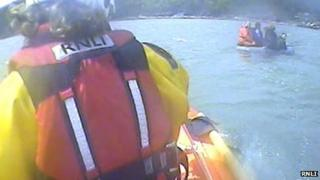 The four men were found holding on to a buoy in Oxwich Bay. Picture: RNLI
