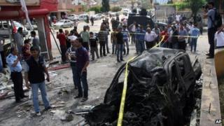 "The site of one of explosions after several explosions killed at least 40 people and injured dozens in Reyhanli, near Turkey""s border with Syria"
