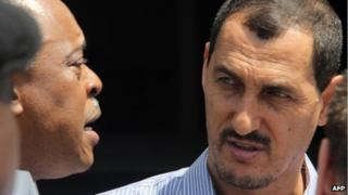 Azim Aghajani (R) outside the Federal High Court in Lagos on 30 April 2013