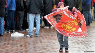 Child holds flag at Old Trafford