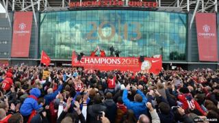 Fans photograph the bus at Old Trafford