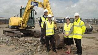 The turning of the first sod of the new boat building hall