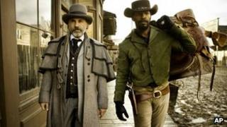 Christoph Waltz as Schultz and Jamie Foxx as Django in the film Django Unchained