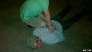 Photo allegedly showing Mr Fogle being held face down on the ground (14 May 2013)