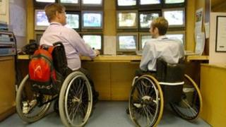 Remploy CCTV control room workers in wheelchairs, Clydebank, in 2004