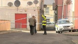 The body was found in the apartment on Lower Main Street in Letterkenny