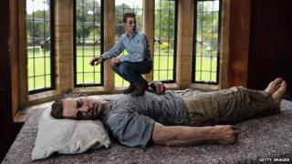 An installation entitled 'Lying Man' by British Artist Sean Henry