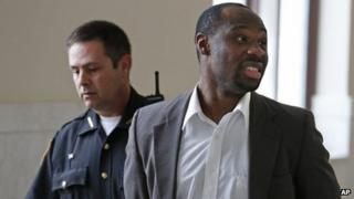 Ricardo Woods being taken from court after he was found guilty in the shooting death Cincinnati 17 May 2013