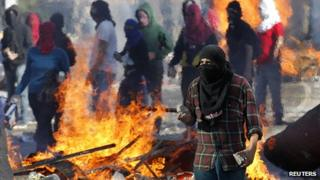 Masked Chilean student clash with riot police (15 May 2013)