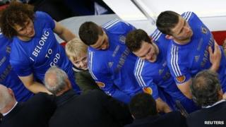 Louis Kearns amongst Chelsea players collecting medals at the Europa League Final