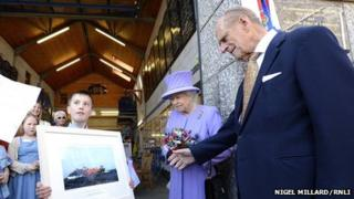 Royal couple given picture of lifeboat. Pic: Nigel Millard/RNLI