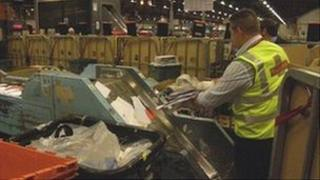 A Royal Mail worker at Gloucester mail centre