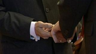 Two men at a civil partnership ceremony