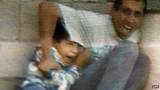 Frame from France 2 footage showing Mohammed and Jamal al-Dura under fire in Gaza (Sept 2000)