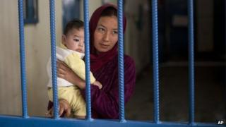 Afghan female prisoner Nuria with her son at Badam Bagh, Afghanistan's central women's prison, in Kabul, Afghanistan on 28 March 2013
