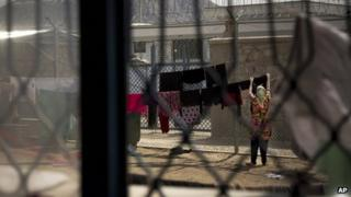 "A woman at Badam Bagh, Afghanistan's central women's prison, in Kabul, Afghanistan - where manyinmates have been convicted of so-called ""moral crimes"""