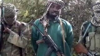 Boko Haram leader Abubakar Shekau flanked by bodyguards (March 2013)