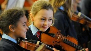 Girls playing violins