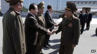 Choe Ryong-hae, front right, shakes hands with officials as he departs for China on 22 May 2013