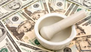 Pestle and mortar on dollar bills