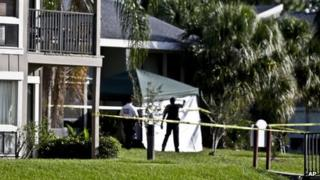 Investigators outside an apartment complex where a man was fatally shot by the FBI in Orlando, Florida, on 22 May 2013