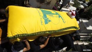 Men carry the coffin of a Hezbollah member killed in the Syrian town of Qusair, during his funeral in Sidon, southern Lebanon (22 May 2013)