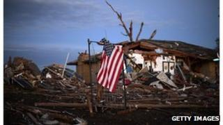 A US flag is seen amongst the debris of a house in Moore, Oklahoma.
