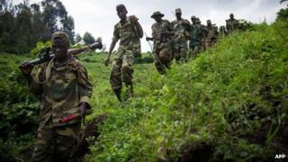 M23 rebels walking through hills in eastern Democratic Republic of Congo (30 November 2012)