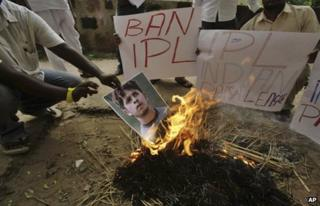 Activists of Kalinga Sena, a local political party, hold placards as they burn a poster of Indian cricketer Shanthakumaran Sreesanth at a protest against spot fixing during the Indian Premier League (IPL) in Bhubaneswar, India, Friday, May 17, 2013