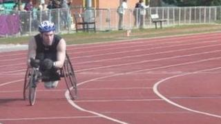 Justin on the track in his racing wheelchair