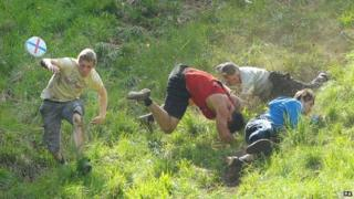 Cheese-rolling racers tumble down Cooper's Hill