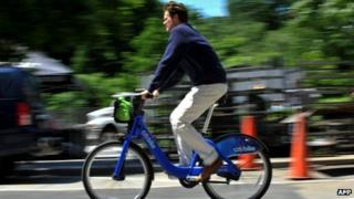 A man rides a Citi bike in New York City, 27 May 2013