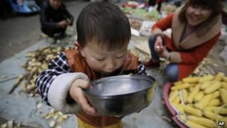 Child drinks from bowl (file image)