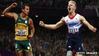 Jonnie Peacock (right) wins men's 100m T44 final at London 2012 Paralympic Games