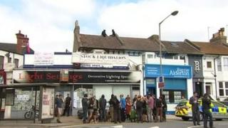 People outside London Road property