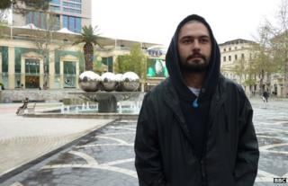 Araz, who says he was beaten up by police at a protest in Baku