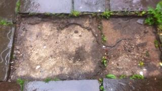 The gap left behind by the stolen flagstones