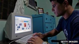 A Cuban man browses an internet website at his house (28/05/2013)
