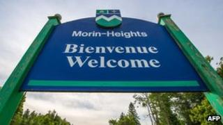 Bienvenue (Welcome) sign in Morin-Heights in the Laurentian Mountains region of Quebec, Canada 3 June 2012