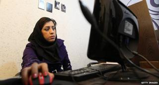 Woman serfing the web at a Tehran internet cafe