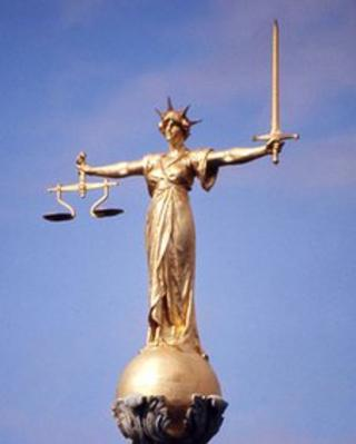 Scales of Justice statue on top of Old Bailey