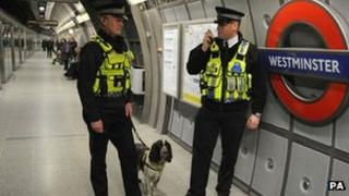 Police officers at a Tube station