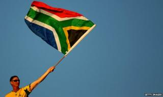 A man waving South Africa's national flag