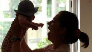 Mother and baby in silhouette file picture