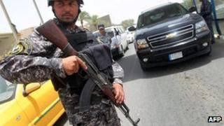 Iraqi policeman at a checkpoint in Baghdad. Photo: 29 May 2013