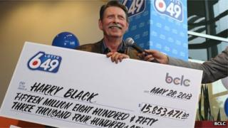 Harry Black with one of his novelty checks