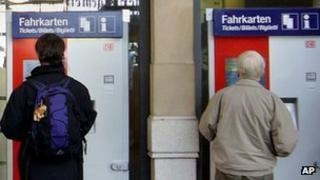 Passengers use Deutsche Bahn's ticket machines in Frankfurt